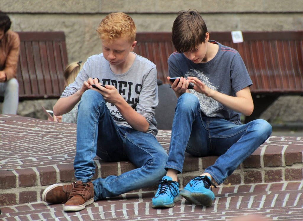 Kids playing mobile games